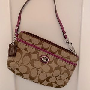 Coach wristlet with pink accents
